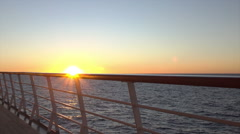Sun shines through cruise ship deck and railing at sunset Stock Footage