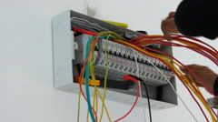 Electrician with circuit breaker - stock footage
