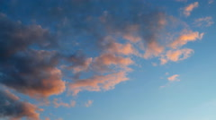 Time lapse clip of pink fluffy clouds over blue sky. Beautiful cloudscape on Stock Footage