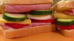 Sandwich with ham, cheese, mayonnaise, tomato, radish, zucchini - stock footage