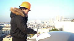Construction supervisor looking at blueprints - stock footage