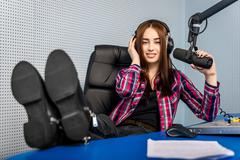 dj working on the radio - stock photo