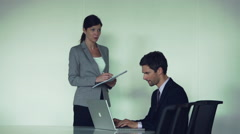 Executive giving instructions to secretary - stock footage