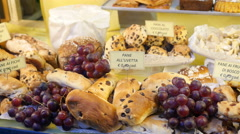 Showcase frontage layout of sweet pastry cakes  - travel Italy Bergamo Stock Footage