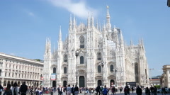 Square of Duomo in Milan Italy - Tourists walk near the Catholic cathedral Stock Footage