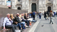 Square of Duomo in Milan Italy People rest tired of hot weather Stock Footage