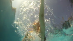 Underwater view of woman swimming in pool Stock Footage