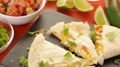 Sliced quesadilla filled with cheese, chicken and pico de gallo. Stock Footage