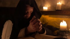 Mysterious medieval monk praying in the walls of the castle in 4K UHD video. Stock Footage