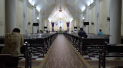 People stand during at night easter service in the Nha tho Vung Tau church Stock Footage