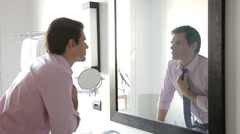 Man looking at self in mirror Stock Footage