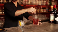 Bartender preparing and pouring negroni Stock Footage