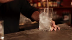Bartender preparing ice for mixed drink Stock Footage
