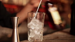 Bartender pouring liqueur into cocktail glass Stock Footage