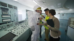4K Astronaut with scientists in space agency control room, preparing for mission - stock footage
