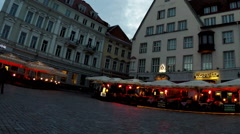 A crowd of tourists visit Town hall square in  Old city on  in Tallinn, Estonia. Stock Footage