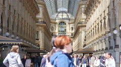 Crowd tourists in Milan Italy - Entrance of Vittorio Emanuele shopping Gallery Stock Footage