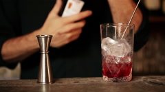 Bartender adding vermouth to cocktail Stock Footage