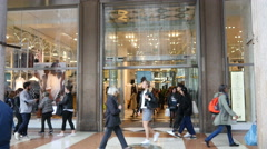 Shopping street of Milan people walking by glass frontage of fashionable store Stock Footage