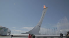 Fountain near the Olympic torch at the World Winter Olympic Games XXII Stock Footage