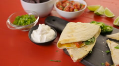 Zoomin shot of  Sliced quesadilla filled with cheese, chicken and pico de gallo. Stock Footage