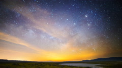 Astro Time Lapse of Milky Way & Moonrise over Wildflower Super Bloom -Tilt Down- Stock Footage