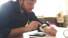 Man using smartwatch and smartphone at the same time Stock Footage