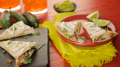 Left pan shot of Sliced quesadilla with cheese, chicken and pico de gallo. Stock Footage