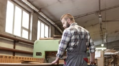 Carpenter doing his job in carpentry workshop in 4K UHD video. Stock Footage