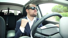 Happy cool business man with sun glasses dancing in car Stock Footage