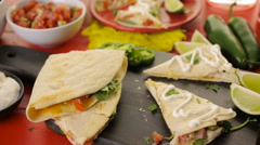 Zoom out shot Sliced quesadilla filled with cheese, chicken and pico de gallo. Stock Footage