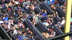 Enthusiastic fans enjoying Baseball - stock footage