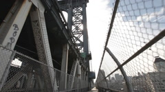 Moving along the pedestrian walkway on the Manhattan Bridge, New York City Stock Footage