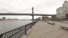 Manhattan Bridge viewed from Empire-Fulton Ferry State Park in Brooklyn Stock Footage