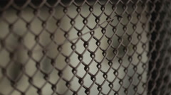 Subway train moving past wire fence - stock footage