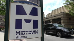 Midtown Atlanta sign on Peachtree Street Stock Footage