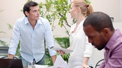 Business associates having casual meeting outdoors Stock Footage