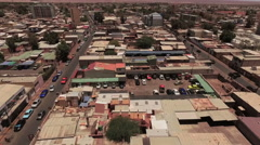 Beautiful small city in the middle of the desert in a sunny day - stock footage