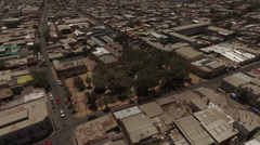 Town in the middle of the bone-dry desert in a sunny day Stock Footage