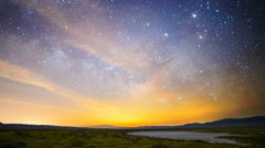 Astro Time Lapse of Milky Way & Moonrise over Wildflower Super Bloom -Zoom Out- - stock footage