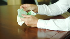 Man counting large stack of banknotes Stock Footage