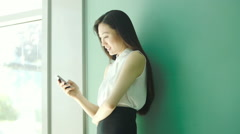 Woman sending text message on smartphone Stock Footage