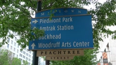 Direction signs on Peachtree Street Atlanta Midtown Stock Footage