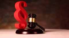 Paragraph, law theme, mallet of judge, wooden gavel - stock footage