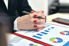 Accountant woman siting in office Stock Photos