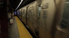 Subway train leaving station Stock Footage