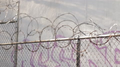 Fence topped with razor wire Stock Footage