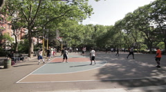 Outdoor basketball game on public court Stock Footage