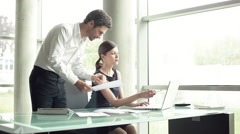 Executives working together in office Stock Footage