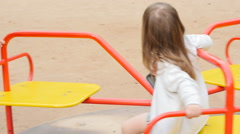 Happy toddler girl on the playground Stock Footage